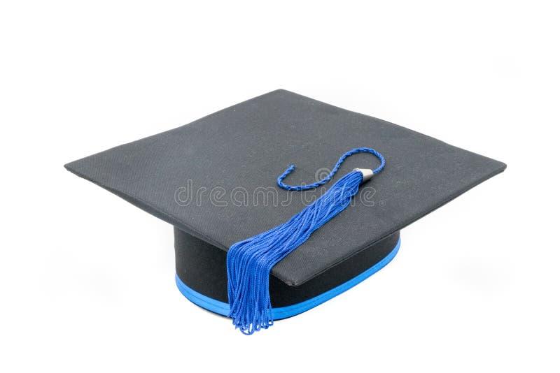 Sombrero de la graduación aislado en el fondo blanco imagen de archivo