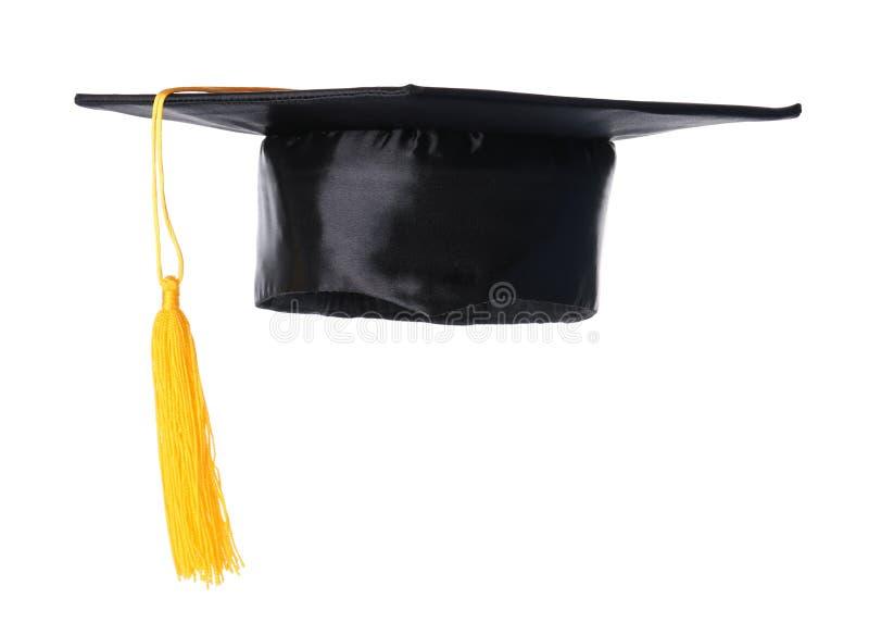 Sombrero de la graduación con la borla del oro fotografía de archivo