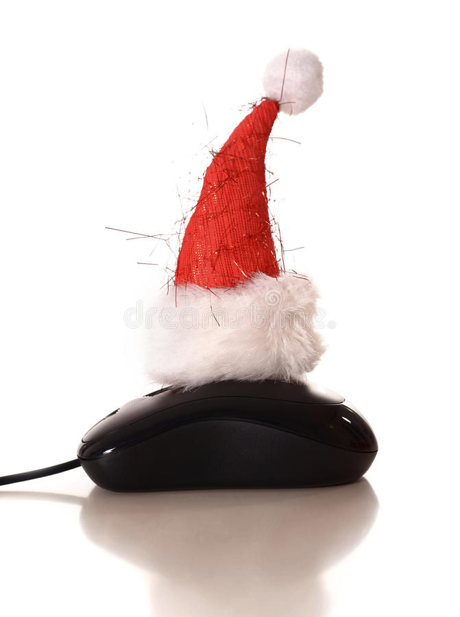Sombrero de la Navidad en ratón del ordenador fotografía de archivo libre de regalías
