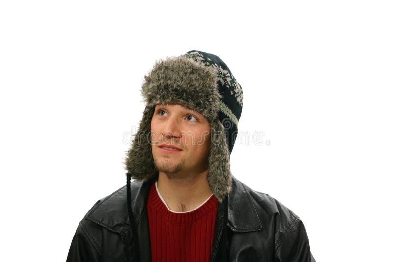 Sombrero de los inviernos del hombre que desgasta fotografía de archivo libre de regalías