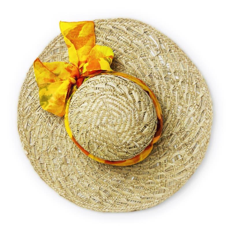 Sombrero de paja femenino del verano de la visión superior con la cinta y el arco amarillo, aislados en el fondo blanco foto de archivo libre de regalías