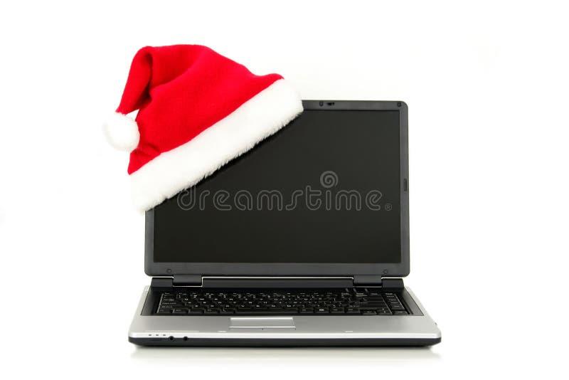Sombrero de Santa en una computadora portátil fotografía de archivo