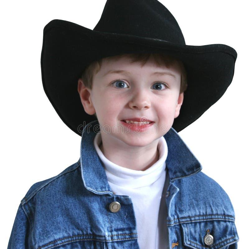 Sombrero de vaquero adorable de cuatro años foto de archivo