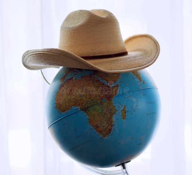 Sombrero de vaquero americano en el globo fotos de archivo