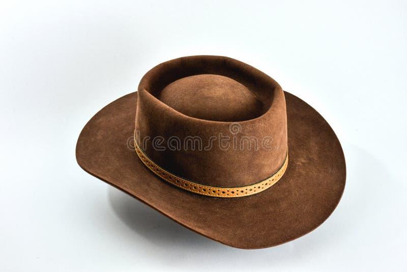 Sombrero de vaquero marrón del vintage en el fondo blanco fotos de archivo libres de regalías