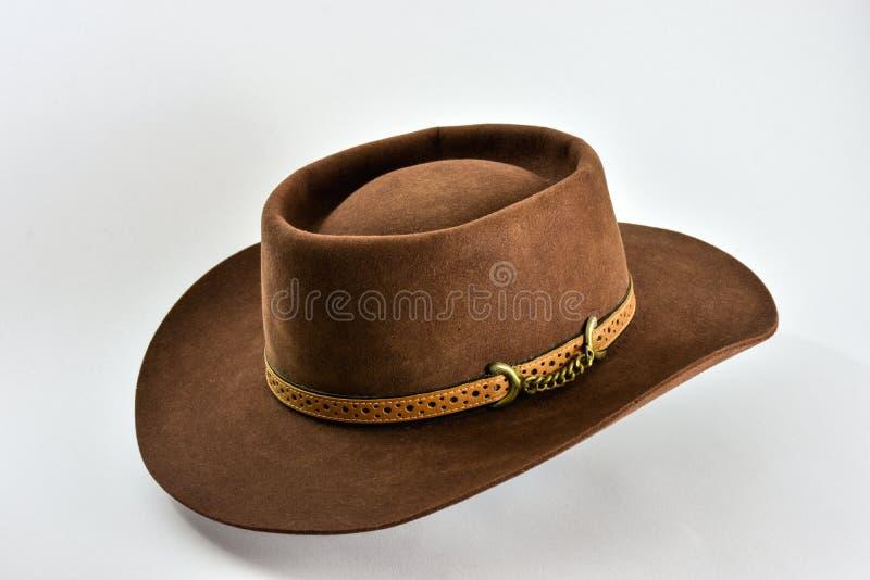 Sombrero de vaquero marrón del vintage en el fondo blanco imagenes de archivo