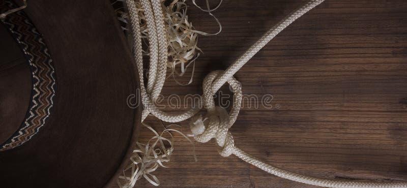 Sombrero de vaquero y lazo imagenes de archivo