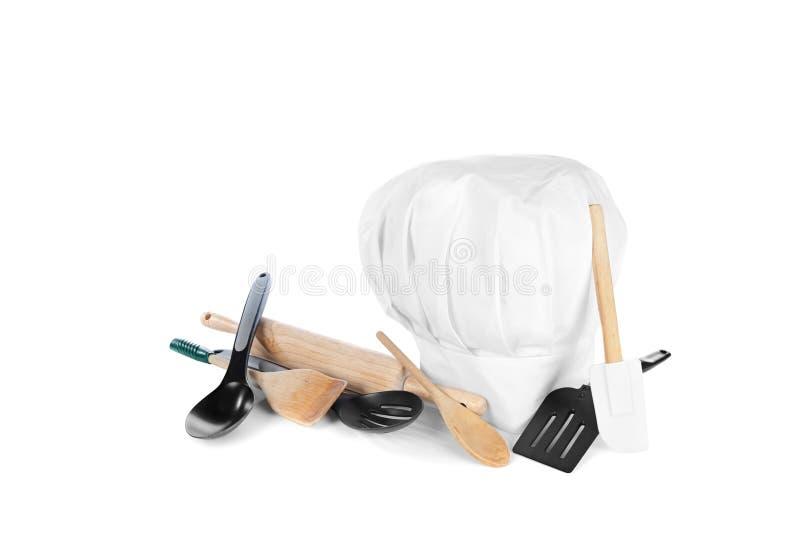 Sombrero del cocinero con los utensilios de cocinar imágenes de archivo libres de regalías