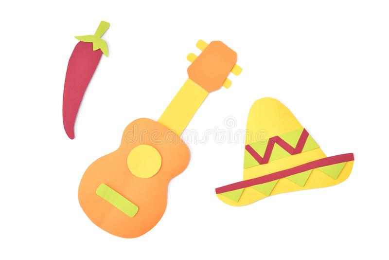 Sombrero and guitar paper cut on white background stock images