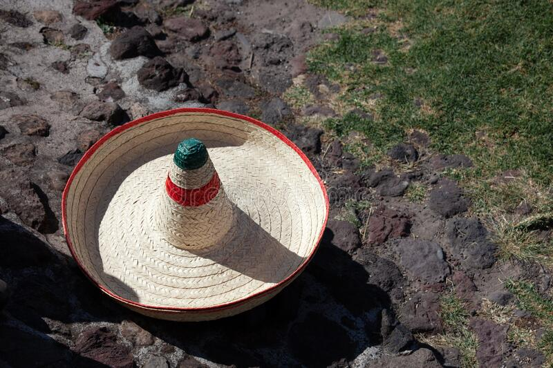 A sombrero hat lies on the floor, on the street, on the grass. royalty free stock photo