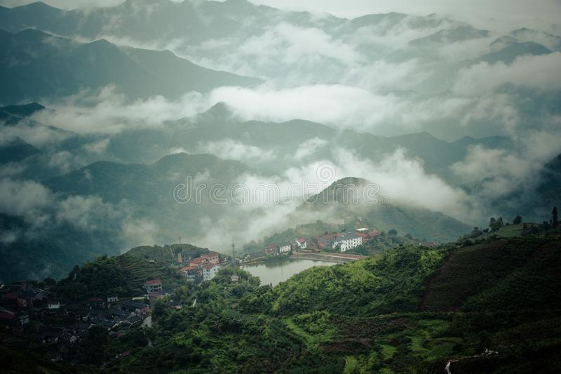 Some ancient villages in Anhui, China, are no longer occupied. They are empty houses. Between the green water and the green hills, in the misty mountains, these stock photo