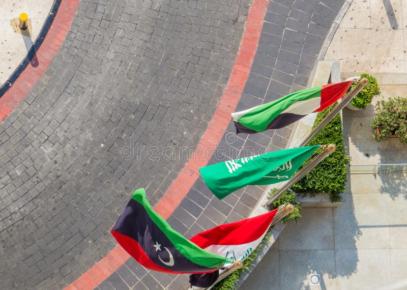 Some Arabic flags from left to right Libya, Iraq, Saudi Arabia and Jordan. Aerial view of some Arabic flags from left to right Libya, Iraq, Saudi Arabia and royalty free stock photo