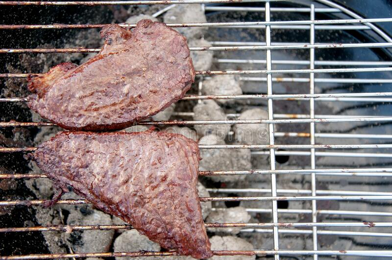 Some barbecue dry aged Kobe roast beef as close-up on a grillage. Close up.  royalty free stock photo