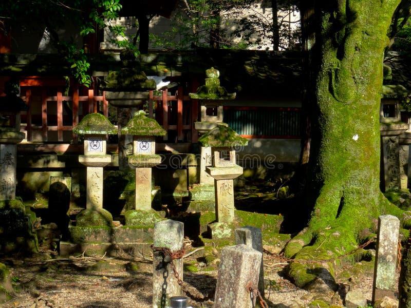 Stone lanterns at the Tamukeyama Hachimangu temple in Nara, Japan stock images