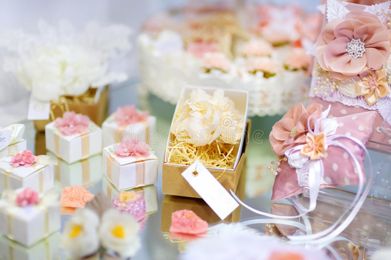 Some beautiful wedding accessories. Decorated with ribbons and flowers on a table stock photography