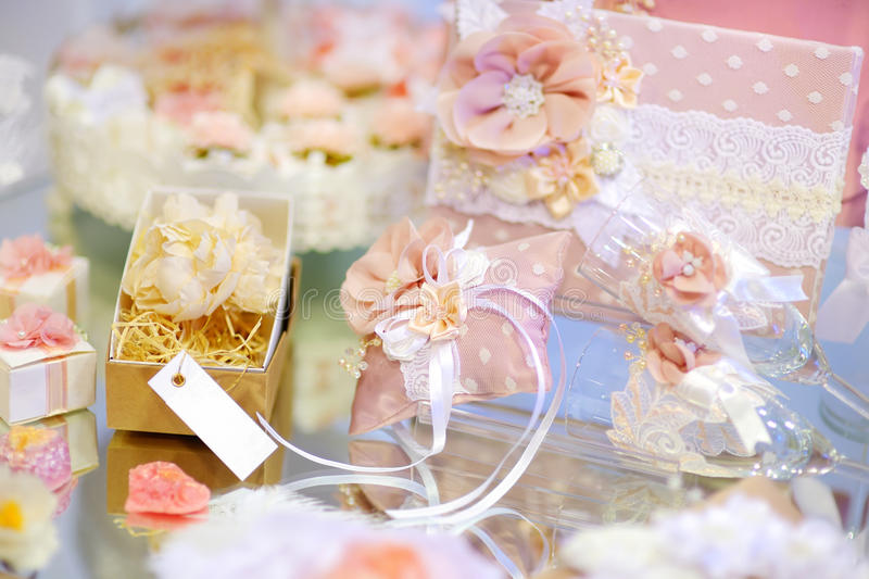 Some beautiful wedding accessories. Decorated with ribbons and flowers on a table royalty free stock image