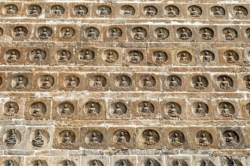Some of the 10.000 brick statues of the Buddha of excellent carving that are inlaid in the walls of the Po Pagoda of Kaifeng. Henan, China. Built in 977, it is royalty free stock image