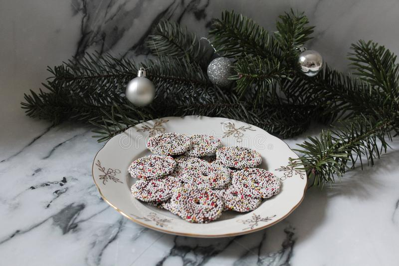 Some cakes with pine-wood. On marble background royalty free stock photos