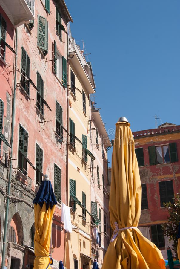 Some colorful houses with yellow umbrellas of Vernazza - 5 Terre royalty free stock image