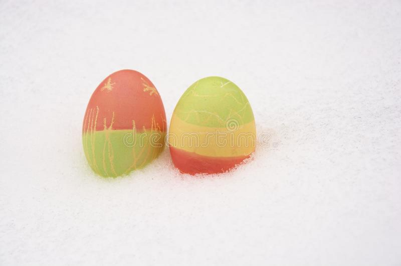 Easter eggs in snow royalty free stock photo