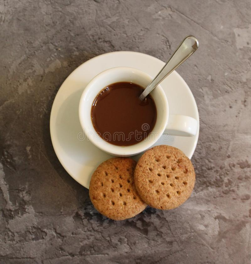 Some delicious cakes and a cup of coffee. Some delicious cakes and coffee on grey, marble background stock photography