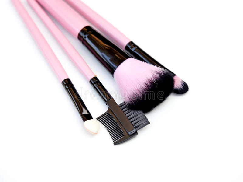 Some different kind of make-up brushes isolated on white. royalty free stock photos