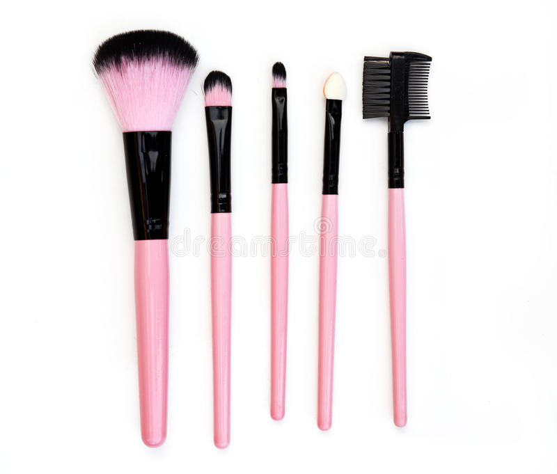 Some different kind of make-up brushes isolated on white. stock images