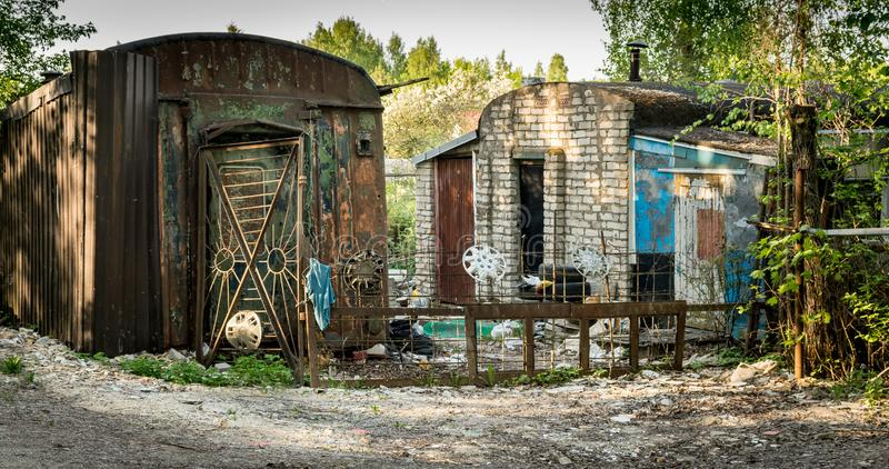 Some dilapidated shacks in the forest. stock images