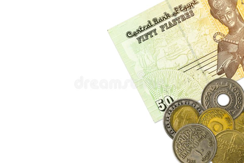 Some egyptian pound bank notes and coins royalty free stock photo