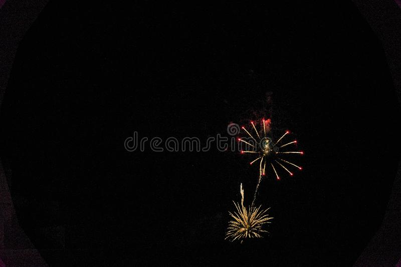 Some fireworks on a black background. They show the appearance of particles used for graphical resources royalty free stock photos