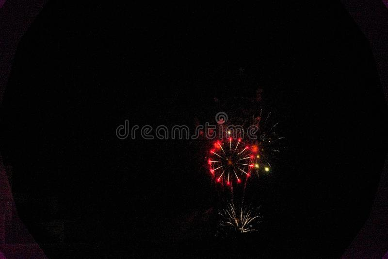 Some fireworks on a black background. They show the appearance of particles used for graphical resources stock photos