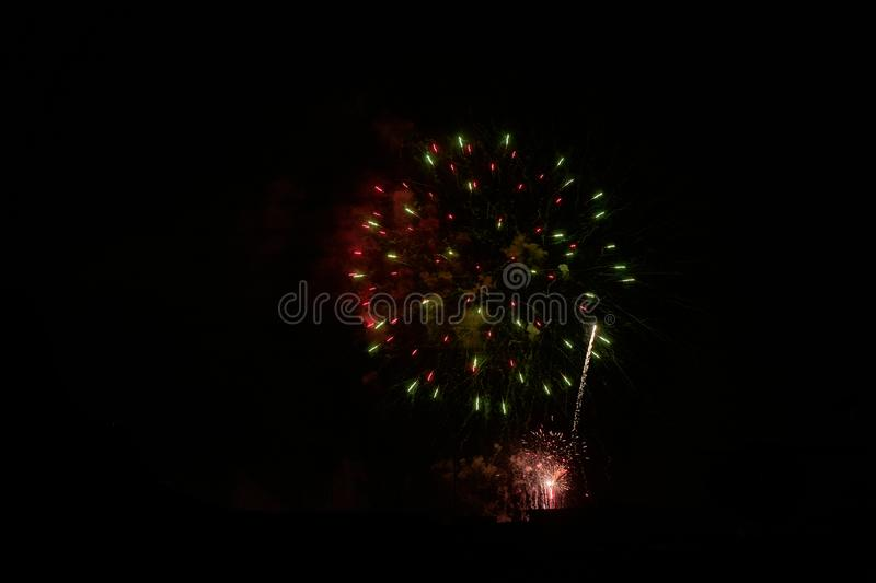 Some fireworks on a black background. They show the appearance of particles used for graphical resources stock photo