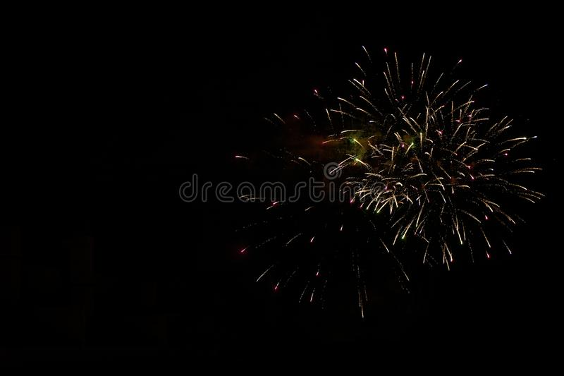 Some fireworks on a black background. They show the appearance of particles used for graphical resources royalty free stock photo