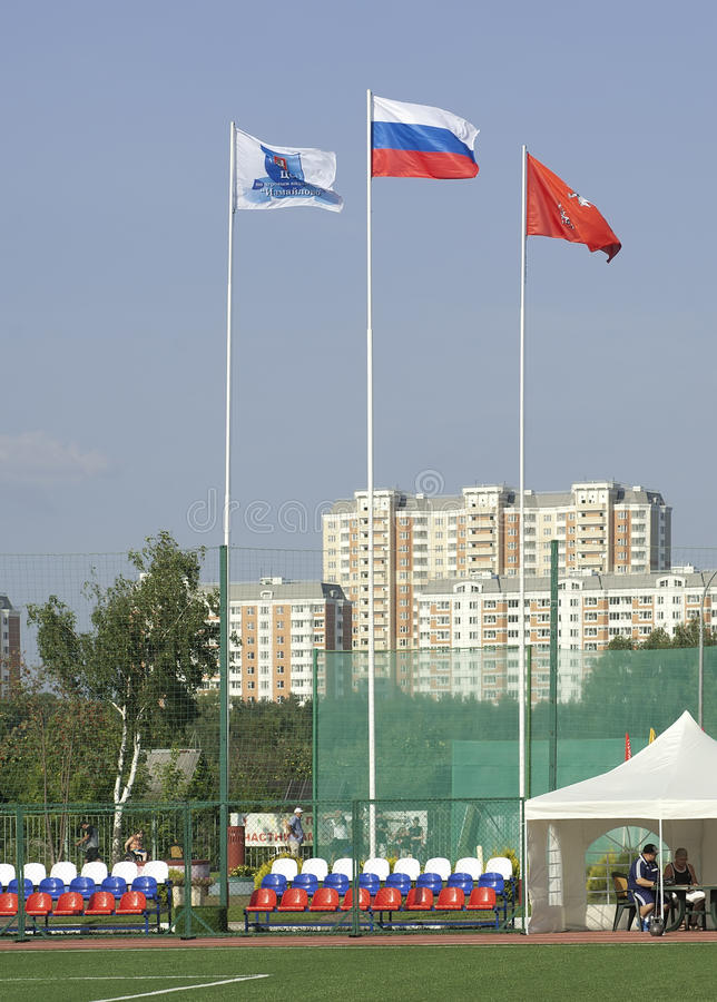 Some flags on football arena stock photo