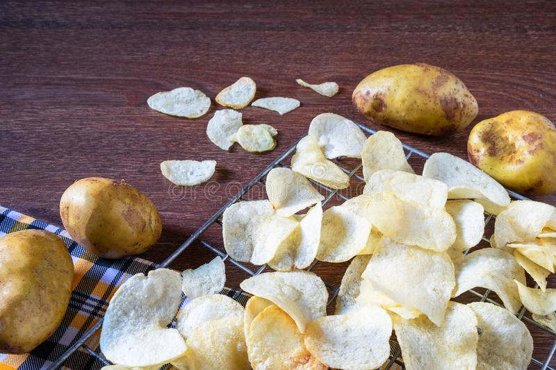 Some fresh fried potato chips. In kitchen royalty free stock images