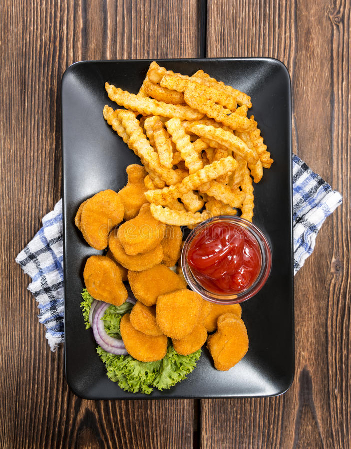 Some fresh made Chicken Nuggets (with chips) stock image