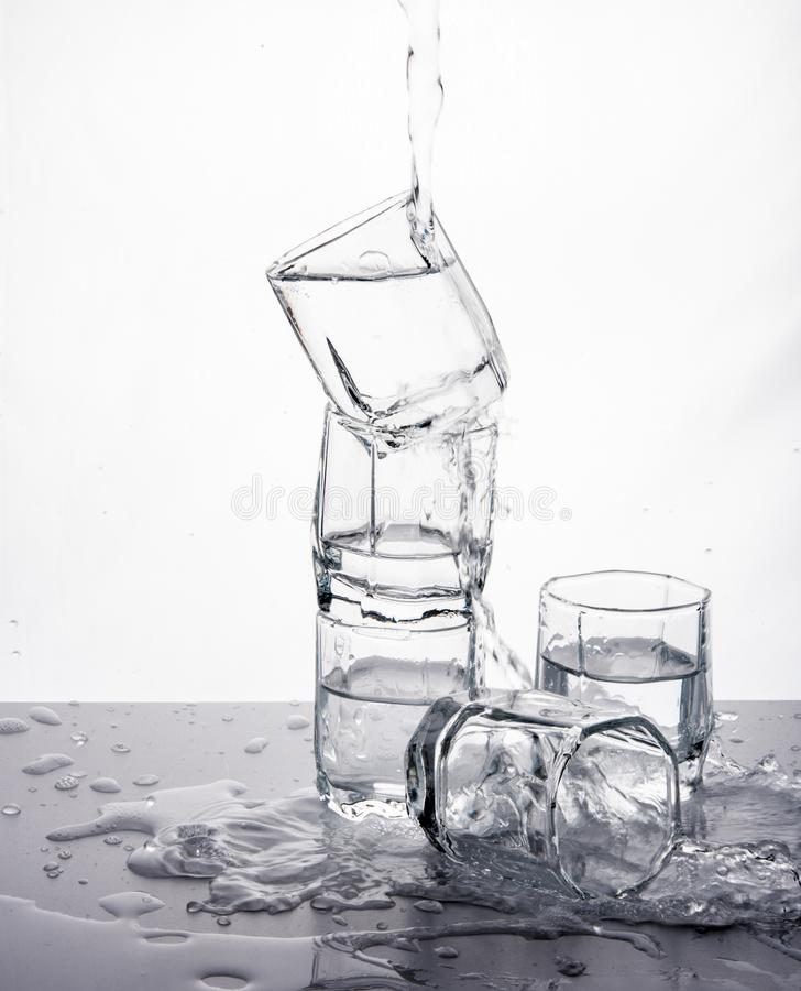 Some glasses water spill black white splash motion mirror. Isolated royalty free stock images