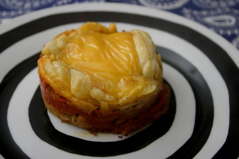 Pies of tuna fish and cheese. Some homemade pies of tuna fish and cheese royalty free stock photos