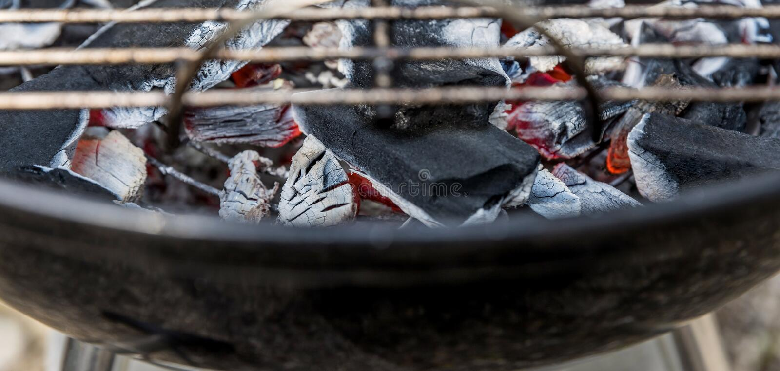Hot Barbecue charcoal on the grill. Some hot Barbecue charcoal on the grill stock image