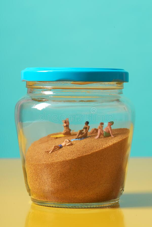 Miniature People In Swimsuit On The Sand In A Jar Stock Photo Image Of Relaxing Glass 184084796