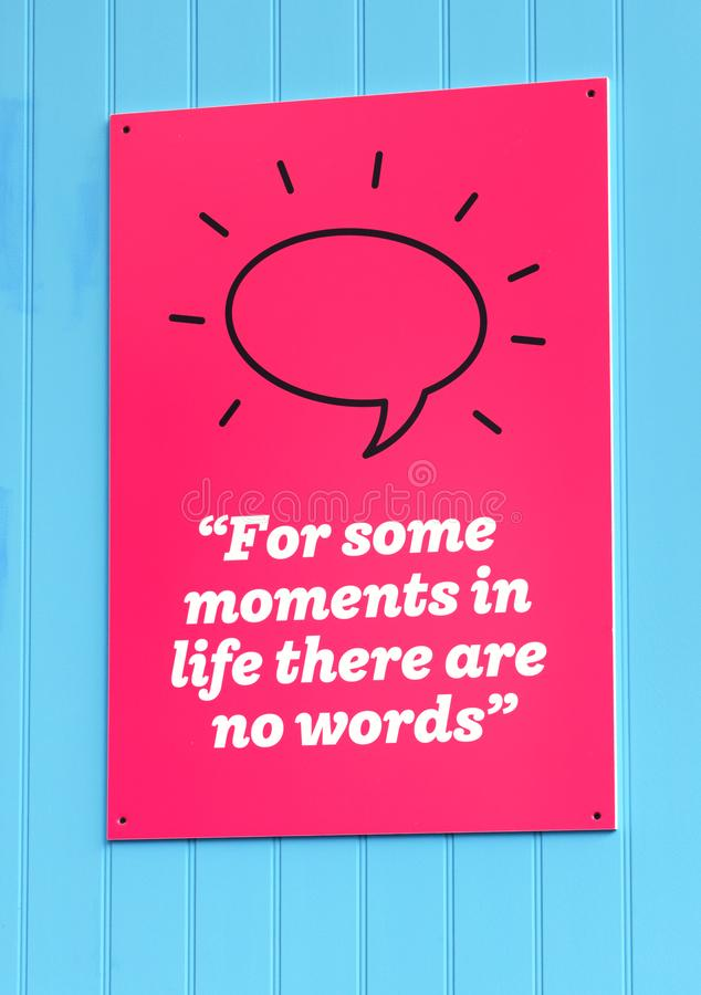 For Some Moments in Life There are No Words sign. A sign on the wall that reads `For Some Moments in Life There are No Words` indicating a pleasurable experience stock photo