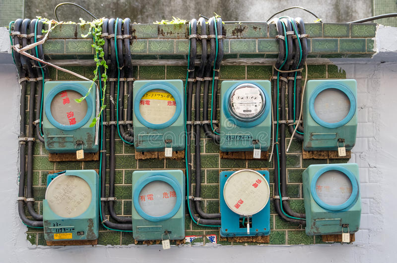 Some old building in Taiwan still using this vintage Analog Electricity Meters. Taipei,Taiwan - March 14,2015 : Some old building in Taiwan still using this royalty free stock photo