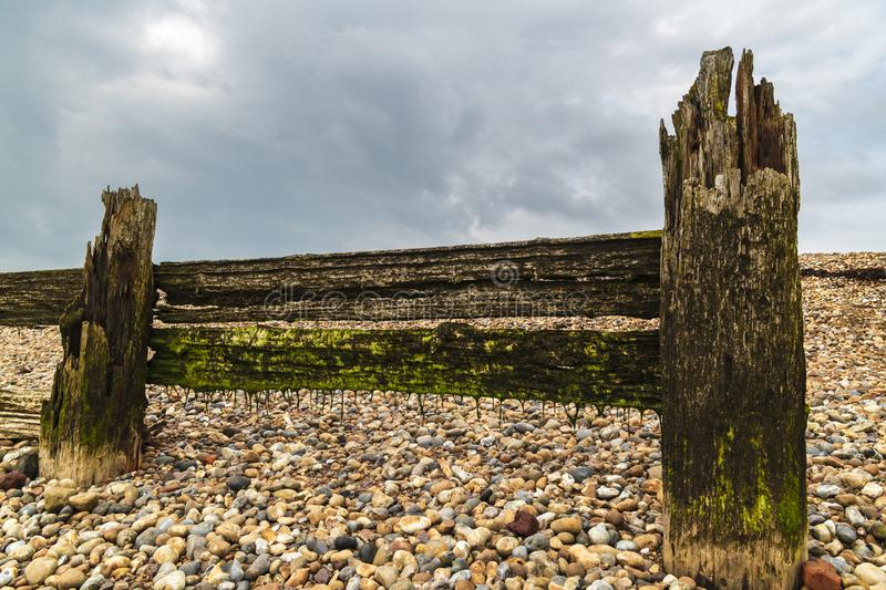 Sea defences at Rye. Some of the old sea defences in the shingle at the entrance to Rye harbour, East Sussex, England. 30 August 2018 stock photography