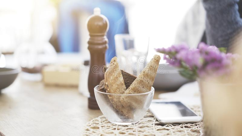 Some pieces of roasted bread in a transparent dish on a table royalty free stock photography