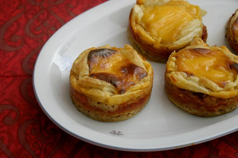Pies with cheese and tuna fish. Some pies with tuna fish, cheese and paprika royalty free stock photo