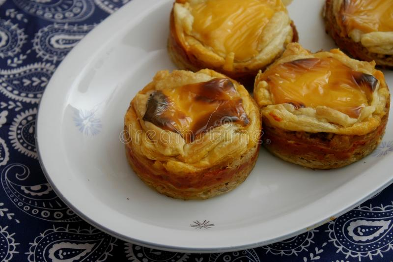 Pies with cheese and tuna fish. Some pies with tuna fish, cheese and paprika royalty free stock photography