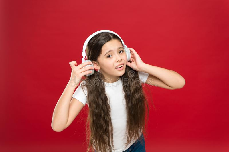 Some problems. Girl sad child listen music headphones. Get music account subscription. Enjoy music concept. Sound. Quality concept. Girl listen song headphones stock photography