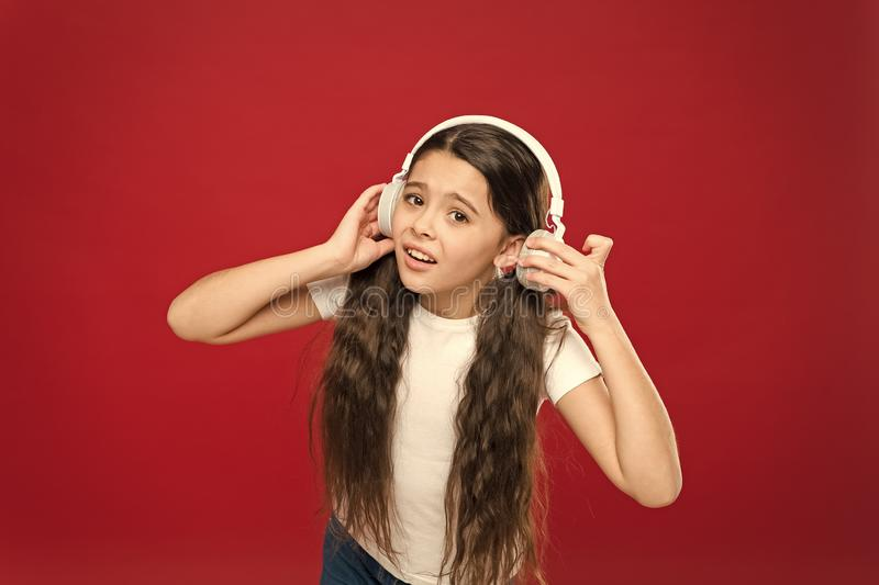 Some problems. Girl sad child listen music headphones. Get music account subscription. Enjoy music concept. Sound. Quality concept. Girl listen song headphones stock photo