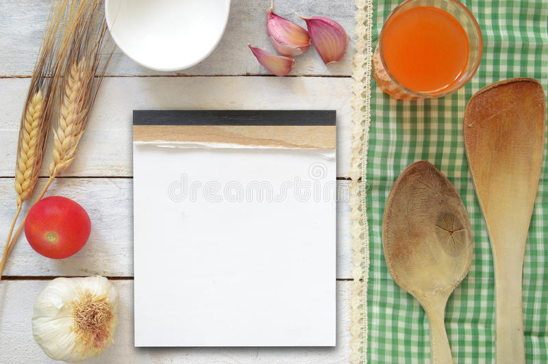Some repice ingredients on a white wooden table decorated with a green tablecloth. Recipe book for the empty space for the editor's text. Top view royalty free stock photos