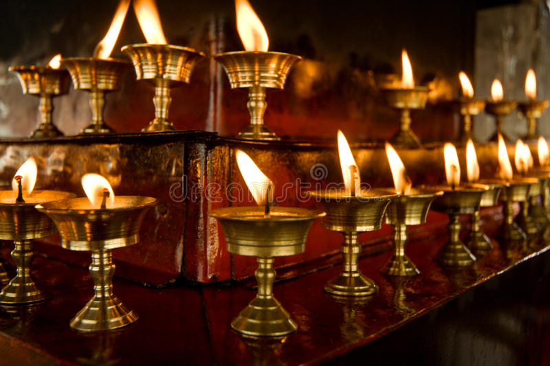 Some Rows Of Candles In Tibetan Temple Stock Photography